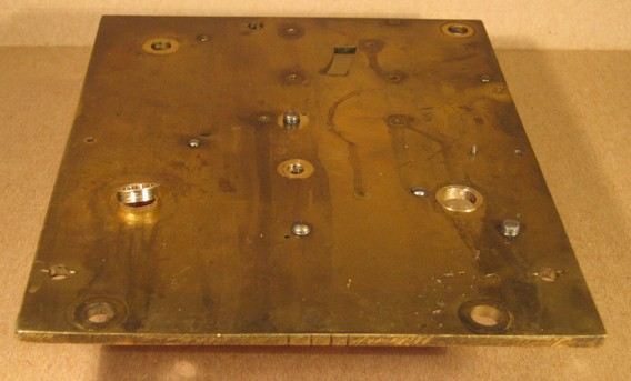 Bushes inserted in a clock plate