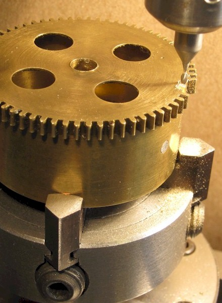 Barrel gear being machined for the roots of replacement teeth