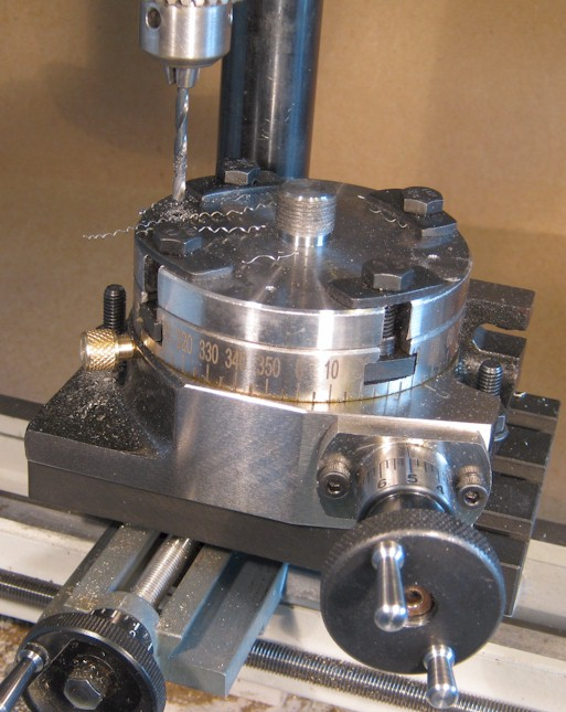 Drilling the rotary table to locate the Unimat adaptor