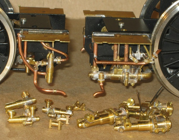 A collection of exhaust and live steam injectors in 7mm scale (0 gauge), fabricated by David L O Smith